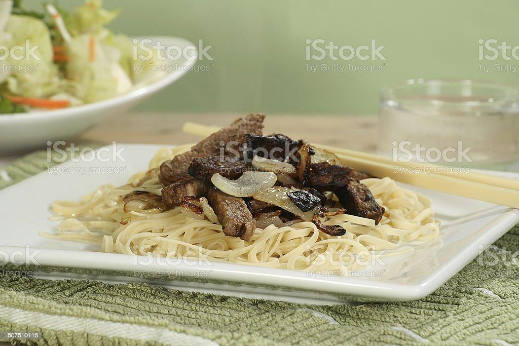 Steak strips with onion stock photo