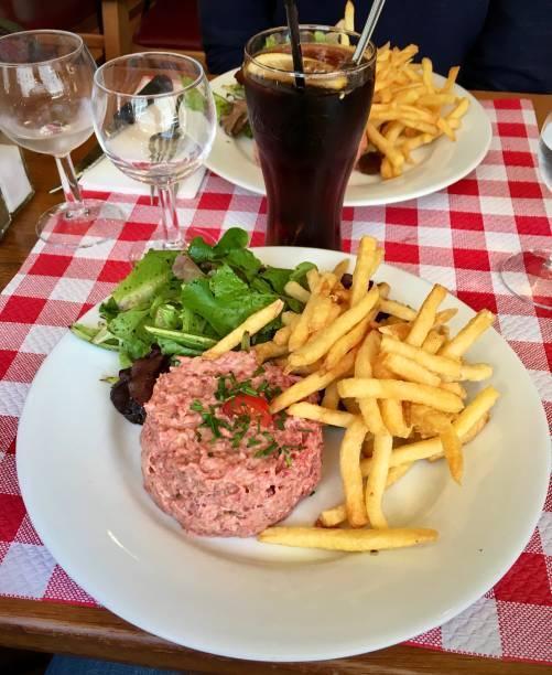 Steak tartare, fries and salad. stock photo