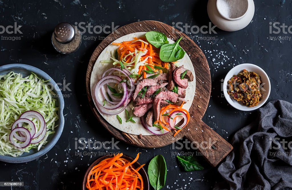 Steak tortilla with pickled carrots and cabbage stock photo