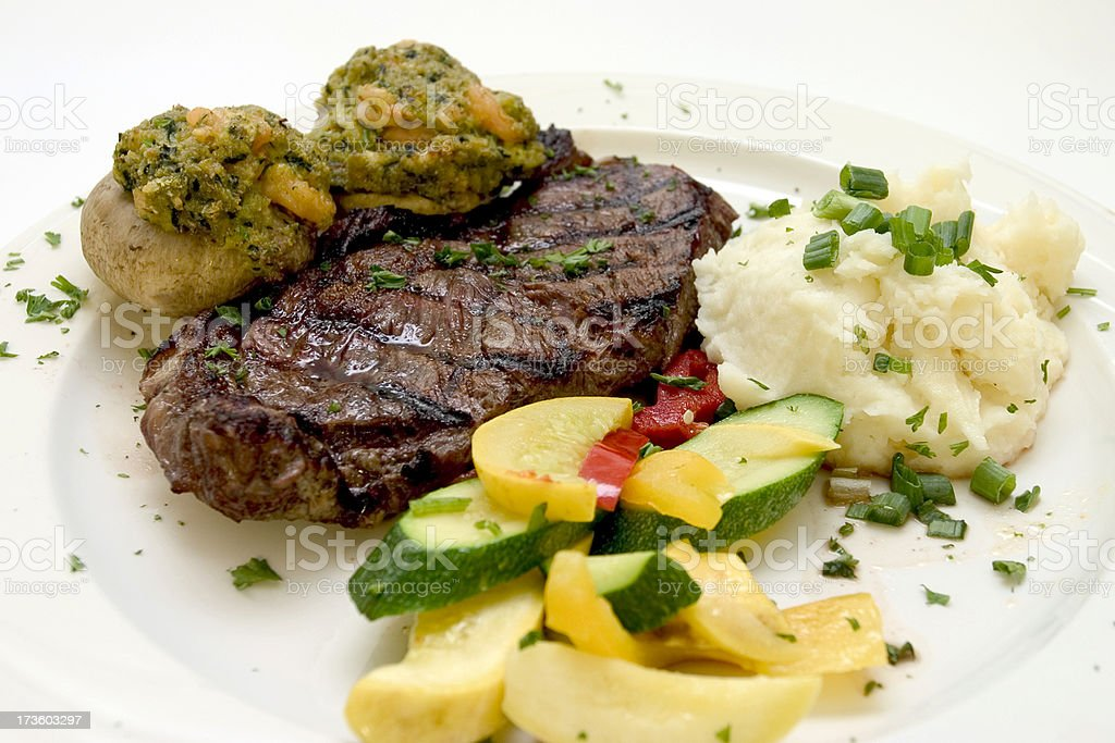 Steak w/ Stuffed Mushrooms royalty-free stock photo