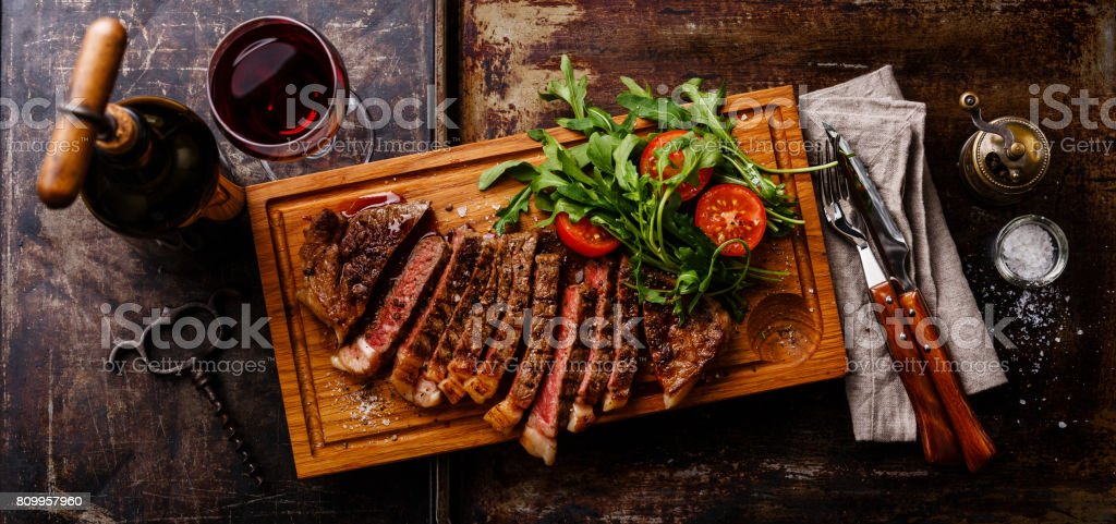 steak with arugula salad and Red wine stock photo
