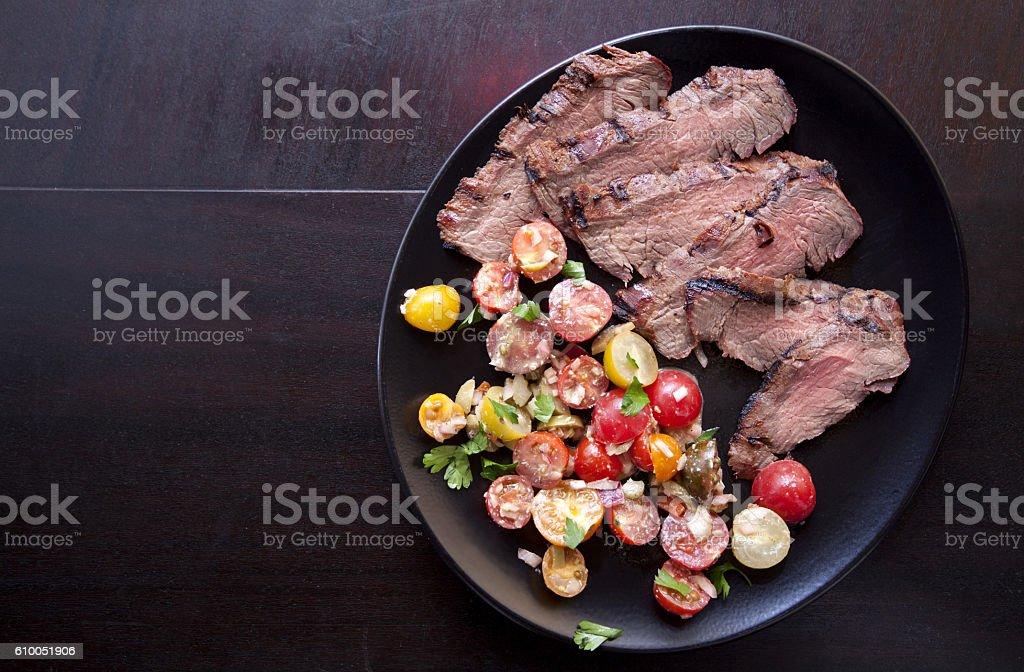 Steak with cherry tomatoes stock photo