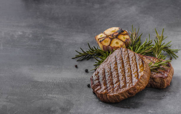 steak with garlic, pepper and herbs - food styling stock photos and pictures