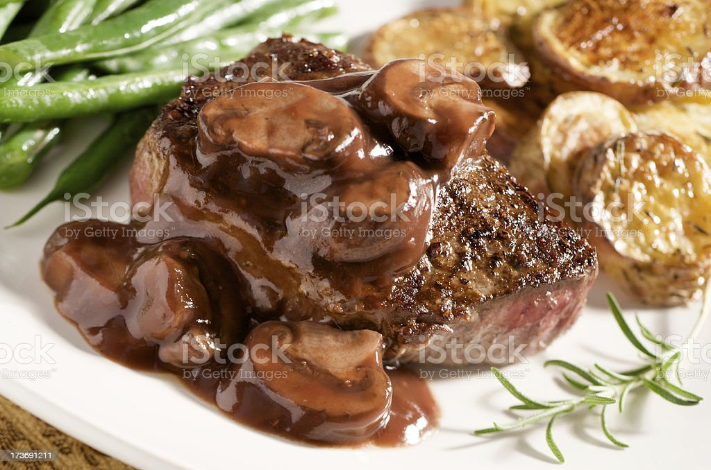 Steak with Mushroom Wine Sauce and Vegetables stock photo