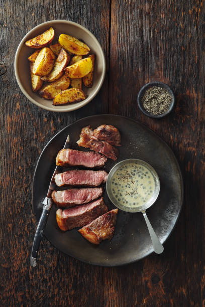 steak with mustard and green peppercorns sauce - beef angus imagens e fotografias de stock