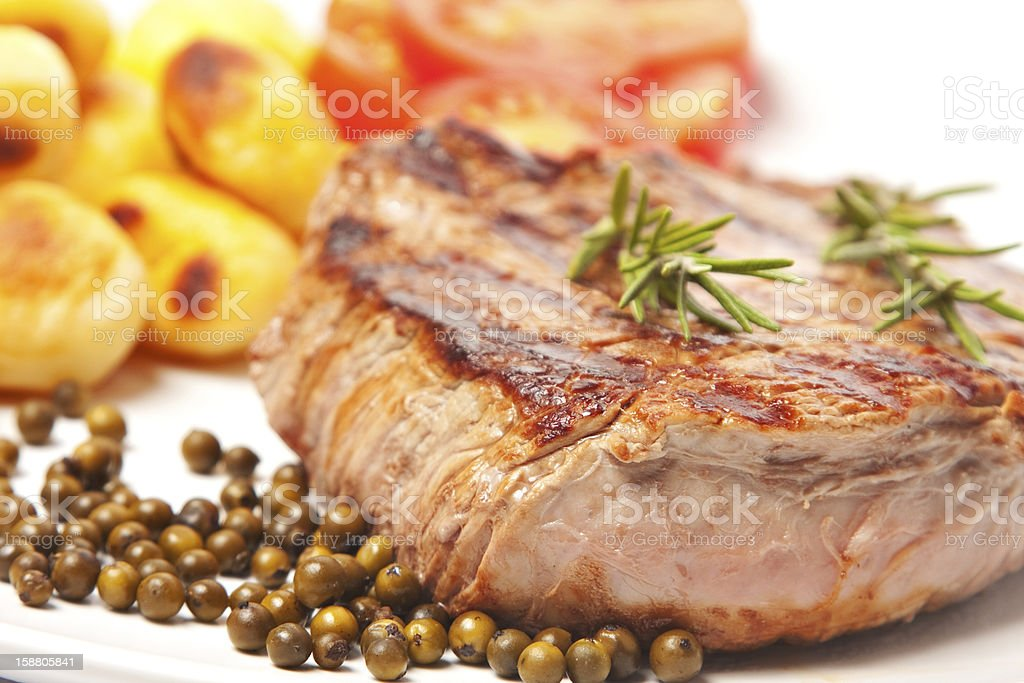 Steak with potatoes and tomatoes stock photo
