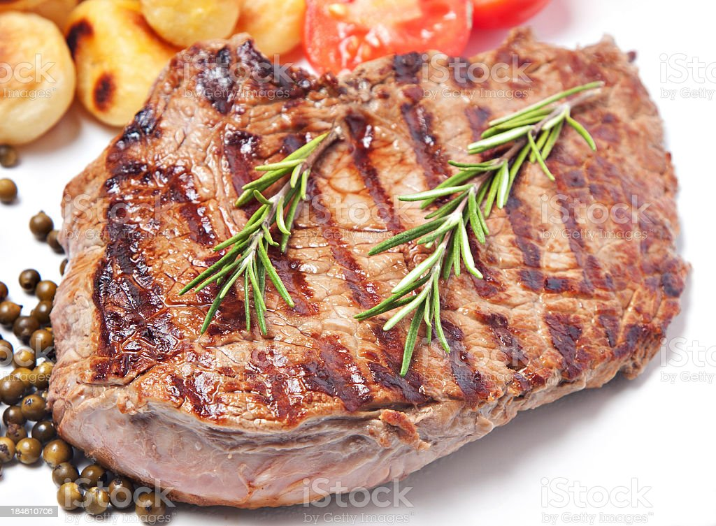 Steak with potatoes and tomatoes royalty-free stock photo