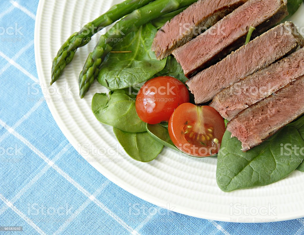 Steak with Tomatoes, and Asparagus royalty-free stock photo