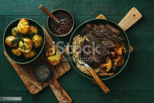 808351106 istock photo Steak with wild mushrooms, quinoa, lingonberry sauce and grilled vegetables 1172225932