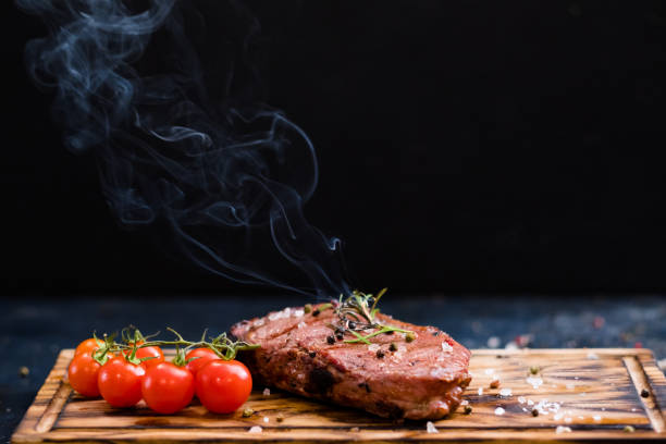 steakhouse menu rib eye steak beef meat rosemary stock photo