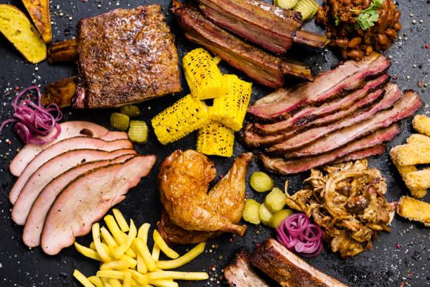 steakhouse menu gerookte vlees assortiment groenten - rib voedsel stockfoto's en -beelden
