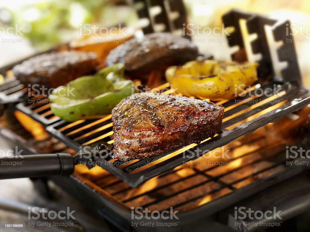 Steaks on a Outdoor BBQ royalty-free stock photo