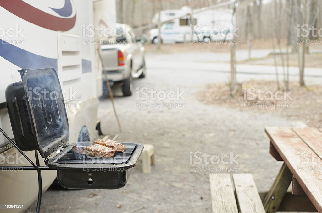 Steaks on the grill at campground royalty-free stock photo