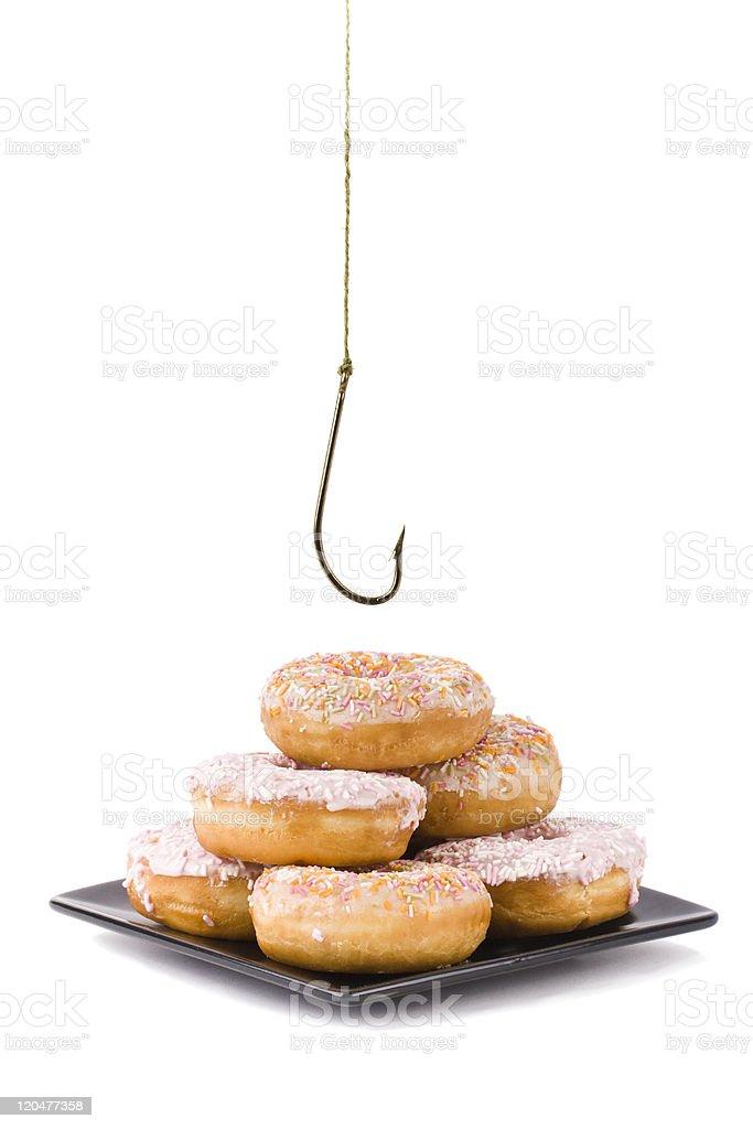 Stealing a doughnut royalty-free stock photo