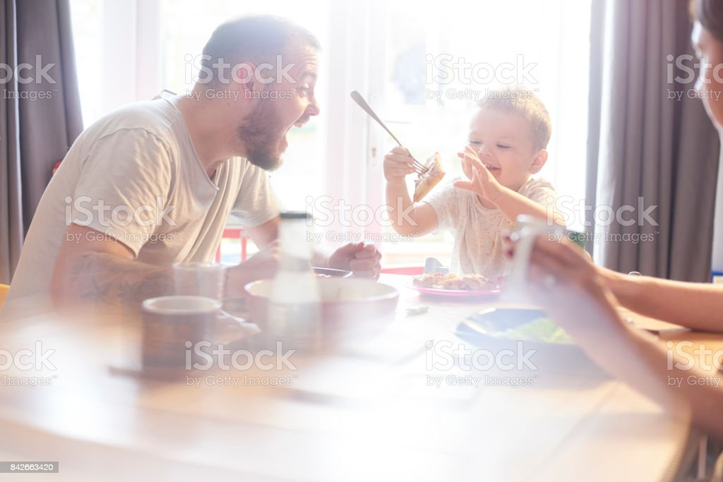 Stealing daddys pizza stock photo
