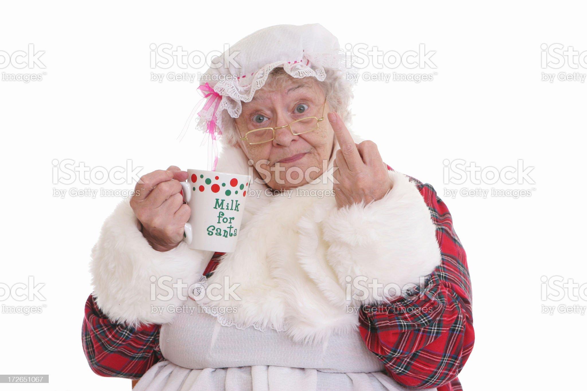 Stealing milk flip off Mrs Claus royalty-free stock photo