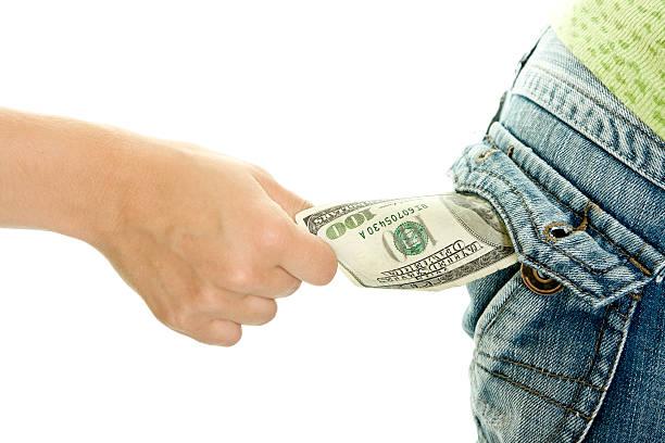 Vol de l'argent isolé sur fond blanc - Photo