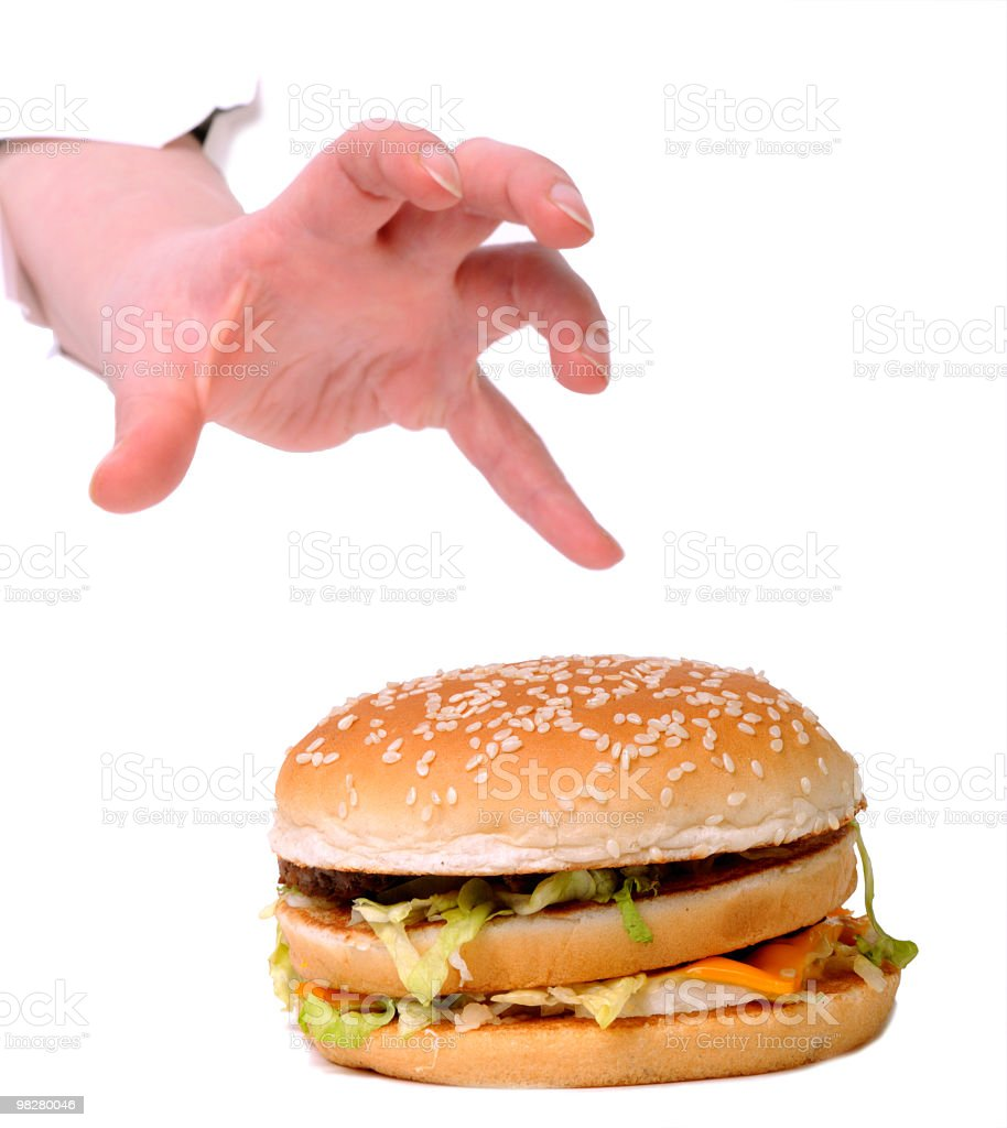 Stealing the burger. Greed conception royalty-free stock photo