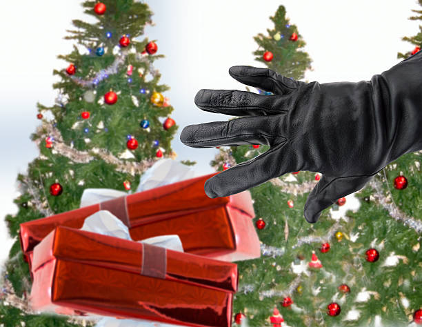 stealing xmas gifts - stealing crime stock photos and pictures