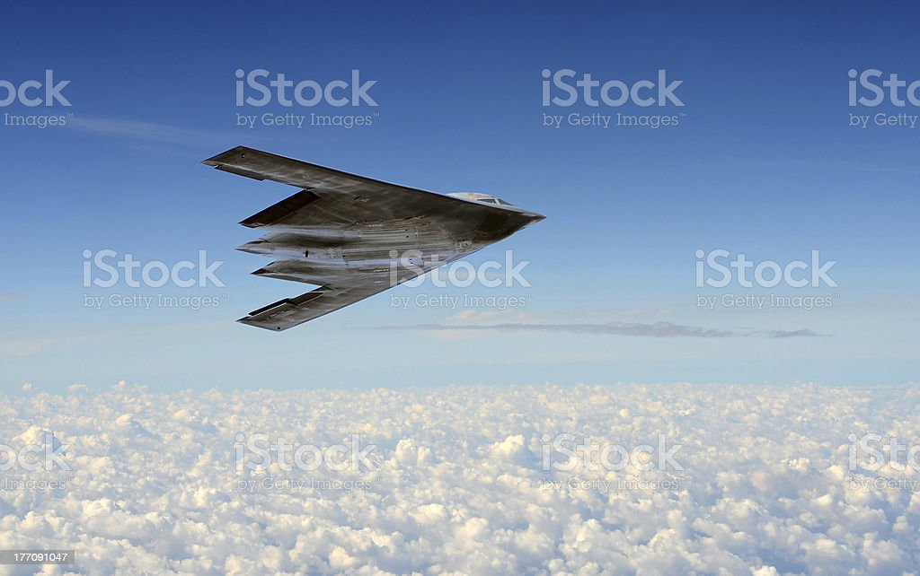 Stealth bomber in flight Modern stealth bomber flying at high altitude Aerospace Industry Stock Photo