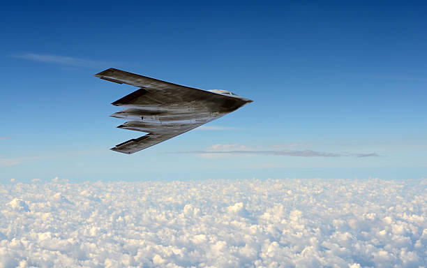Stealth bomber in flight Modern stealth bomber flying at high altitude bomber plane stock pictures, royalty-free photos & images