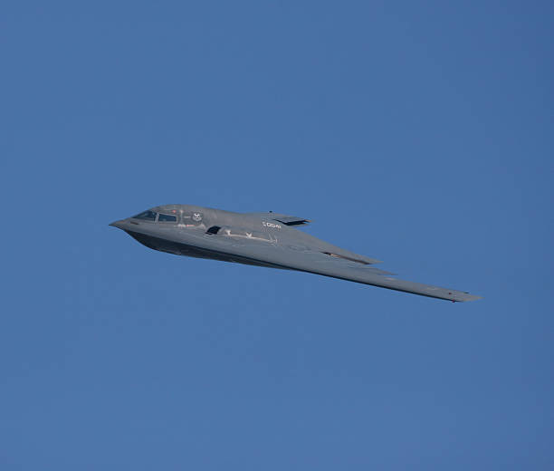 B-2 Stealth Bomber In Flight Lakewood, United States- July 17, 2010: Joint Base Lewis-McChord opens its gates to the public for a free airshow.  This image shows a B-2 Stealth Bomber airplane in flight. northrop b 2 stealth bomber stock pictures, royalty-free photos & images