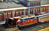 istock Steam and diesel trains on the railway station. Tilt shift 134144594