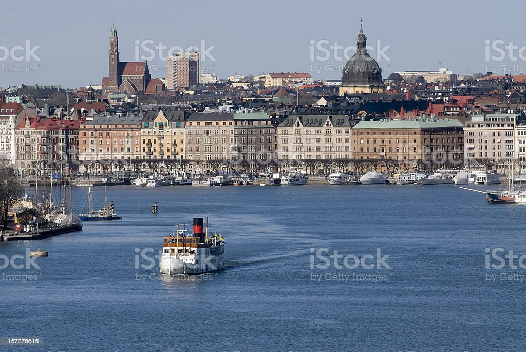 A steam boat trip on a river near a city royalty-free stock photo