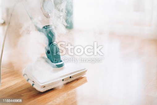 istock Steam cleaner mop cleaining floor. Banner with copy space. Cleaning service concept 1155445908