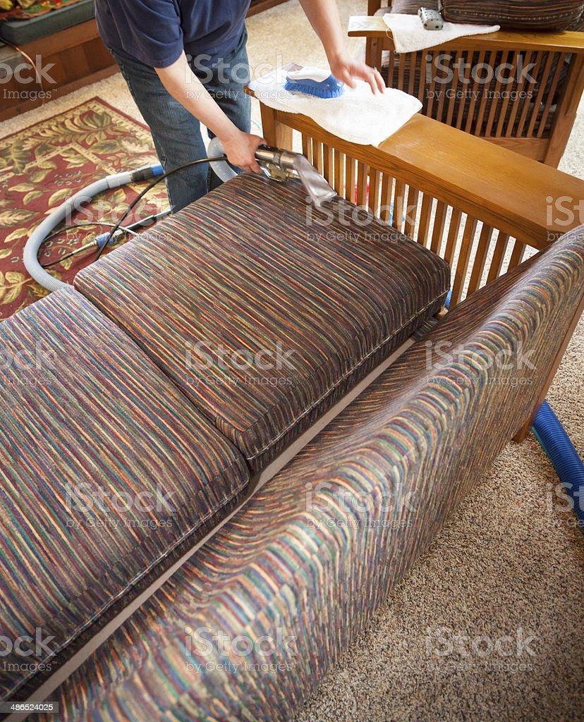 Steam cleaning sofa stock photo