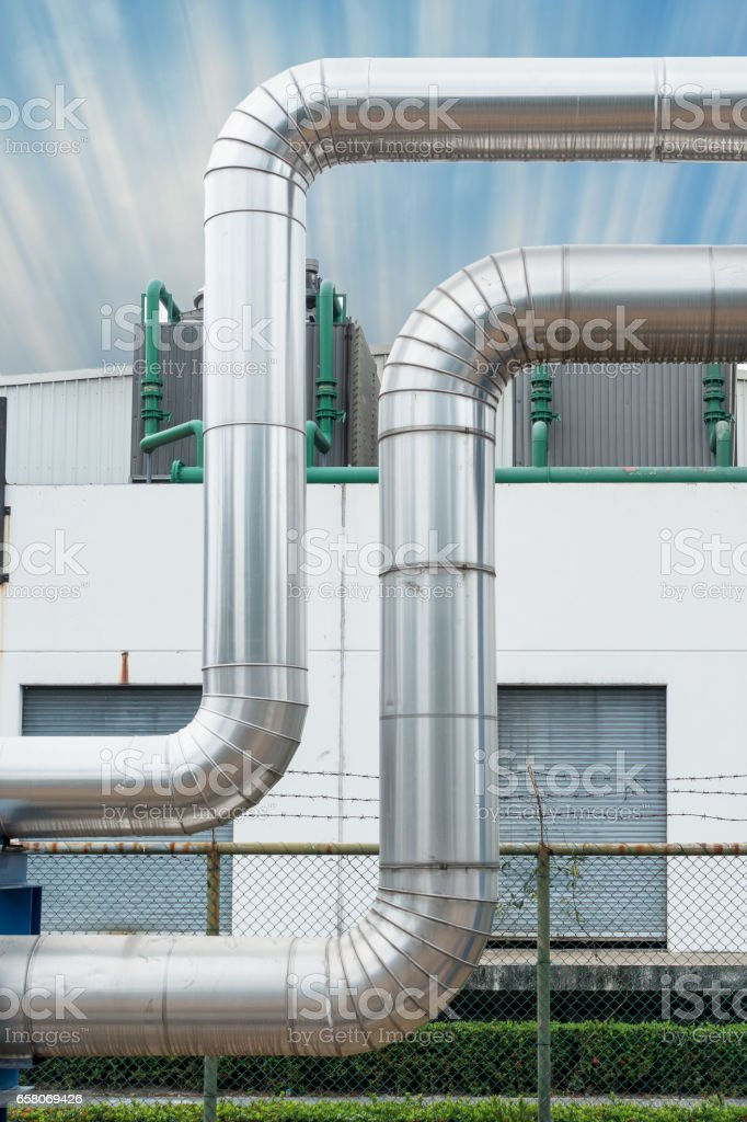 Steam distribution pipeline and insulation cover. royalty-free stock photo