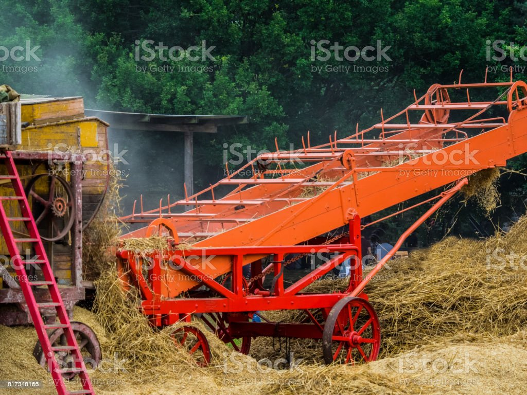 Steam driven hay thresher and bale machine stock photo