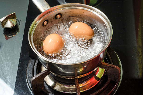 Steam, eggs and boiling water stock photo