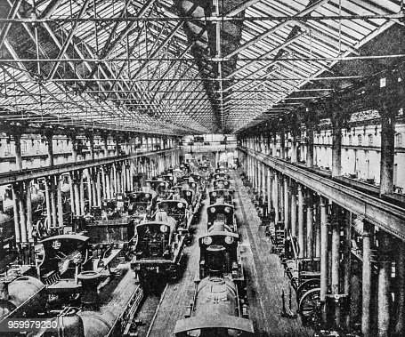 Steam engine trains in an erecting shop in Derby. Heavy industry inside a train yard in Derby from the pre-1900 book