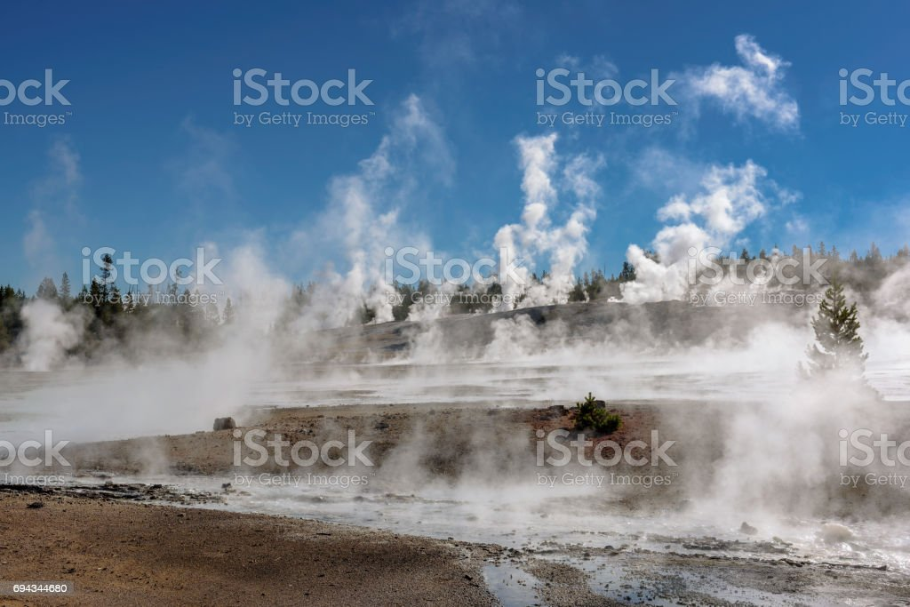 Steam from geysers in Yellowstone stock photo
