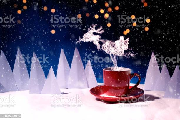 Steam in reindeer and santa claus into sled shape flying over red mug picture id1162735916?b=1&k=6&m=1162735916&s=612x612&h=ivtotzg9l7z37kbl7w2ytw6kclezjdlld9vc05aqfuo=