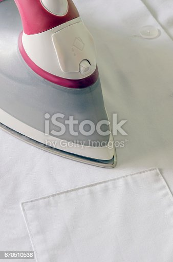 istock Steam iron in pink 670510536