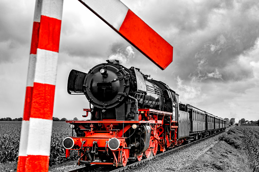 Steam locomotive and railway crossing sign