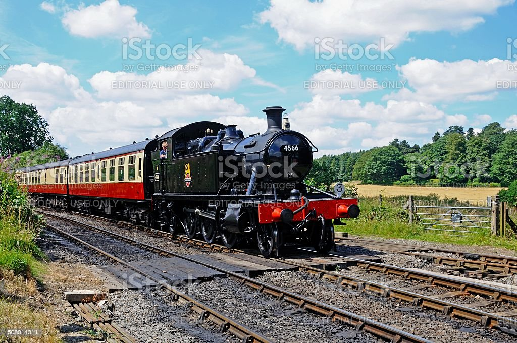 Steam locomotive approaching Arley Station. stock photo