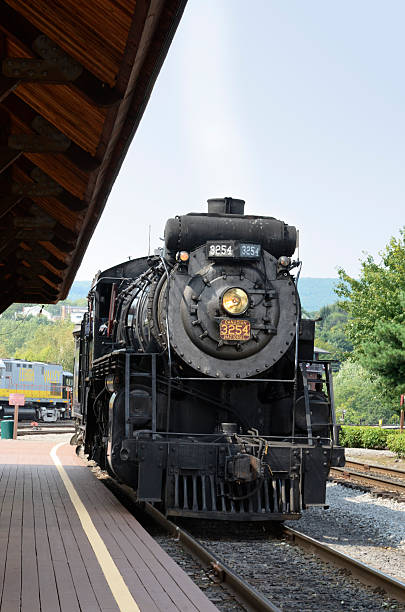 steam locomotive approching train station - scranton pa stock photos and pictures