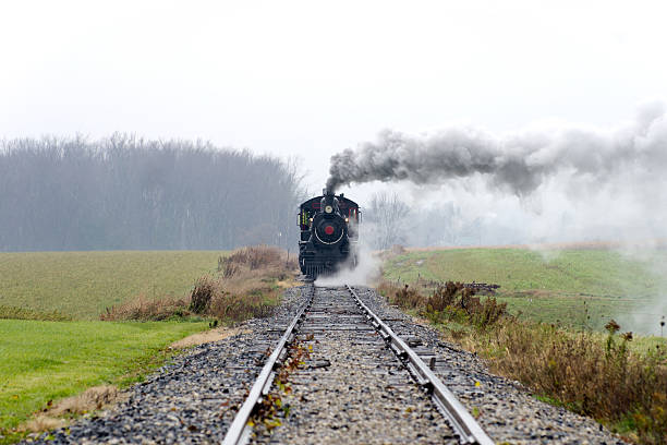 Steam Locomotive Coming Down the Track stock photo