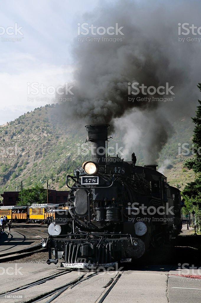 Steam locomotive in motion stock photo