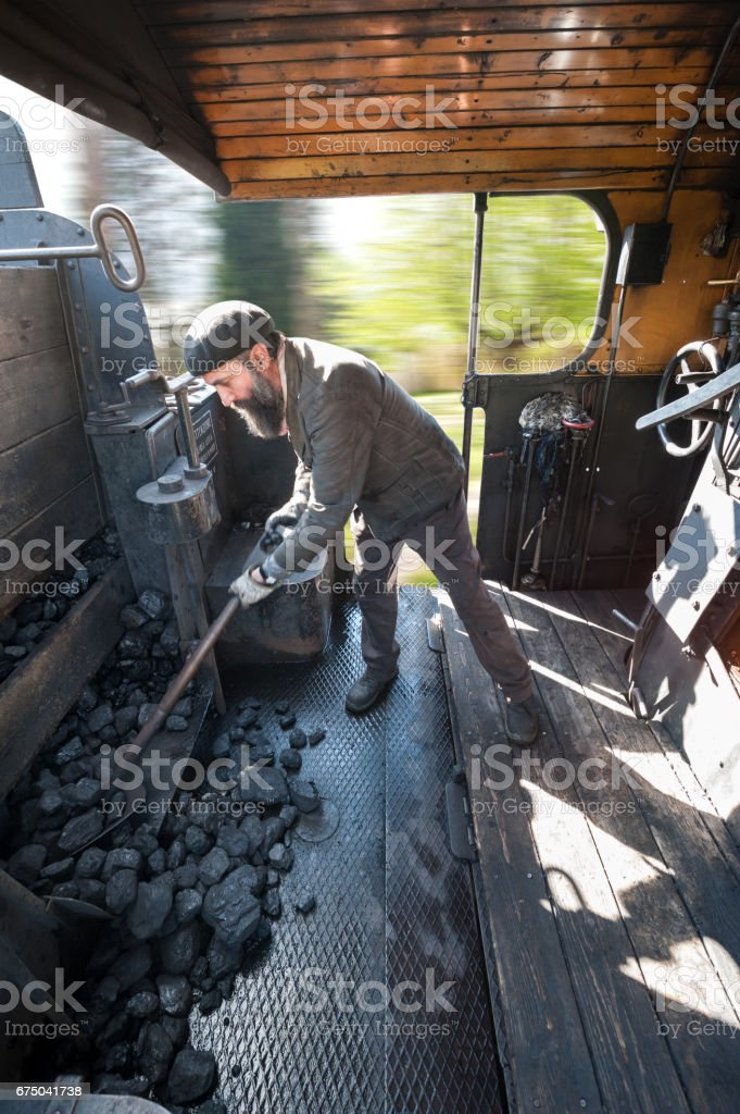 Steam locomotive runs at full speed in the countryside stock photo