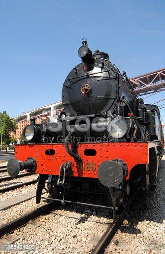 Lisbon, Portugal: CP steam train under the Salazar / 25 de Abril bridge - front view.