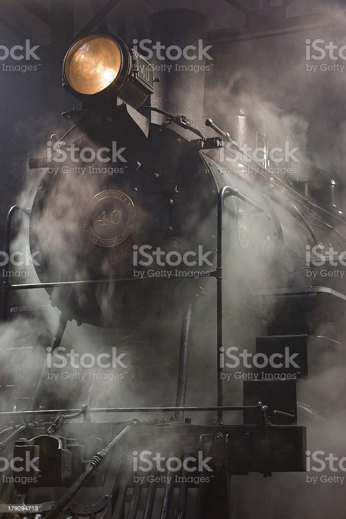 Steam Locomotive wreathed in condensation stock photo