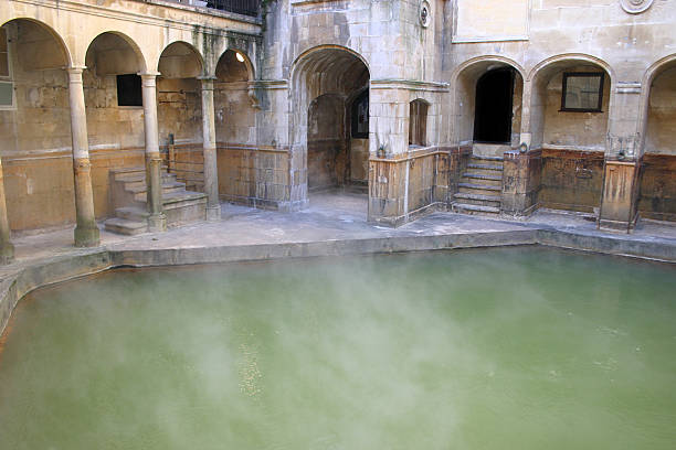 Steam off a Roman Bath Steam coming off a Roman Bath at Bath in England roman baths england stock pictures, royalty-free photos & images