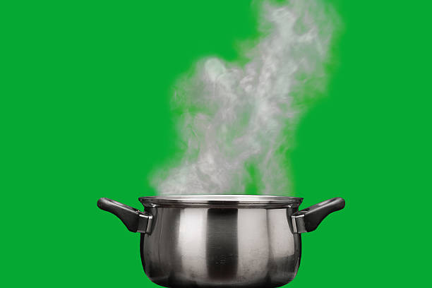 steam over cooking pot - kookgerei stockfoto's en -beelden