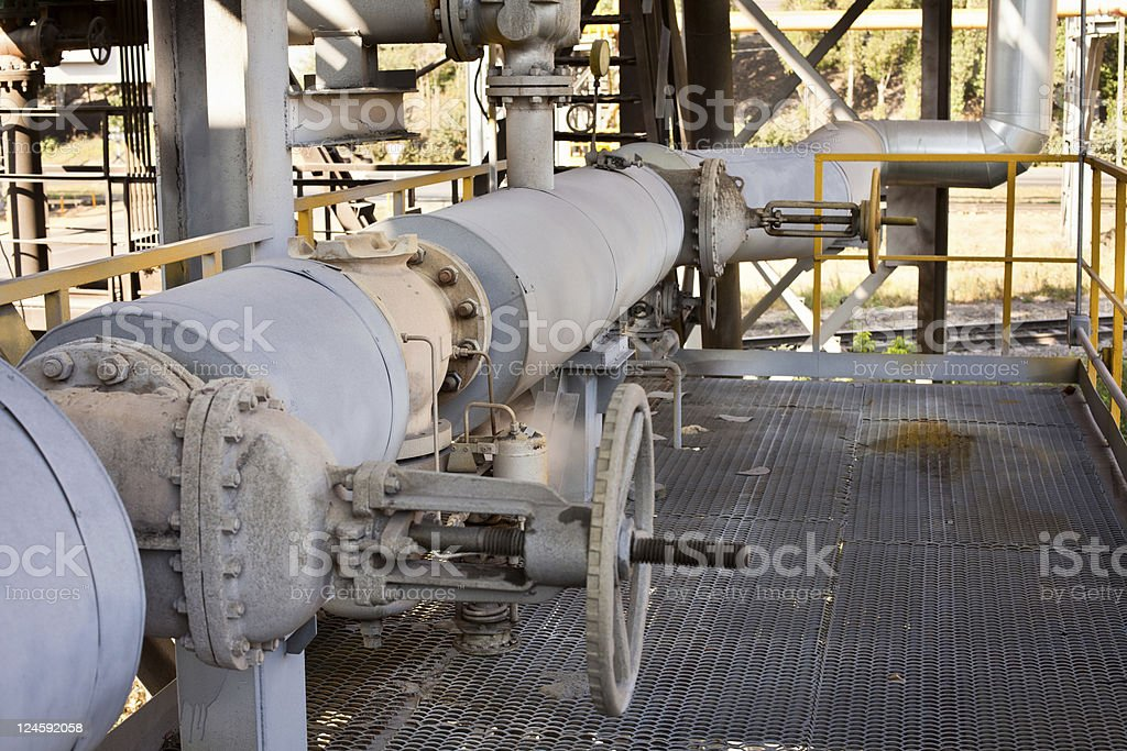 Steam pipe valves and service platform royalty-free stock photo