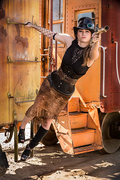 Steam Punk girl with pistol stock photo