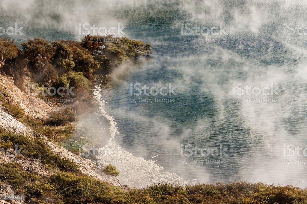 steam raising from thermal lake in Waimangu stock photo